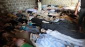 Lokale har bragt omkomne til et rum i en midlertidig klink i Damaskus-forstaden Ghouta i Syrien den 22. august 2013. Dagen før fandt det mest dødelige angreb med kemiske våben sted. Op mod 1.400 omkom ved angrebene.