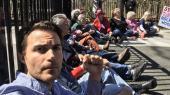 Kai Newkirk var en af arrangørerne af demonstrationen mod Rockwool foran den danske ambassade i Washington, D.C. I en tale spurgte han, hvordan det kan hænge sammen, at danske børn er beskyttet mod at indånde forurenet luft, mens amerikanske børn i deres by og amt i West Virginia ikke bliver det.