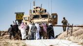 Syriske kurdere demonstrerer og forsøger at gøre den amerikanskledede koalition opmærksom på truslen fra Tyrkiet. Basen ligger i udkanten af byen Ras al-Ayn i Syriens Hasakeh-provins.