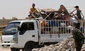 Beslaglæggelsen af 160 USB-nøgler har løftet sløret for, hvordan en gruppe militante ekstremister med indtægter fra syriske oliefelter har vokset sig stærk nok til at kunne erobre Iraks næststørste by