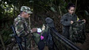 FARC-medlemmerne Juan og Tania kan måske snart pakke camouflage-uniformer, geværer og laptops sammen, hvis fredsforhandlingerne bærer frugt.