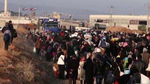 Syrere på flugt fra Aleppo mod Bab al-Salama, der ligger på den tyrkiske grænse. Op imod 50.000 flygtninge er strømmet mod grænsen siden regimets offensiv i byen.