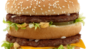 Den høje danske mindsteløn burde give tårnhøje priser på f.eks. fast-food, men gør det ikke. Hvorfor?