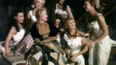 Humøret er højt og tempoet raskt i Stanley Donens musical, der har Howard Keel og Jane Powell i hovedrollerne som umage ægtepar i 1850'ernes Oregon