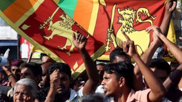 Sri Lankanere fejrer, at regeringsstyrker har indtaget Kilinochchi, De Tamilske Tigres de facto hovedstad gennem mere end 20 år.
