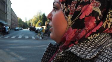 Kritikere anklager den såkaldte tørklædelov for både at være unødvendig og diskriminerende over for muslimske kvinder, der bærer tørklæde.Arkiv