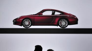 Skønt Tysklands bilindustri også har bidraget til det økonomiske boom, er det især de små og mellemstore industri-virksomheders produktion, der har været nøglen til landets vækst. Her udstilles Porsche-modeller i Stuttgart.