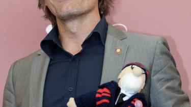 Viggo Mortensen dukkede op til pressekonferencen i Venedig med en dukke, der var iført holddragten for det argentinske fodboldhold San Lorenzo.