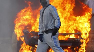 Mærket. Under sidste års optøjer i London bar plyndringsskarerne ikke kun Adidas-tøj på kroppen, men også i armene, når de tømte butikkerne for varer.
