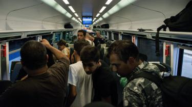 Flygtninge ombord på et tog til München fra Budapest.