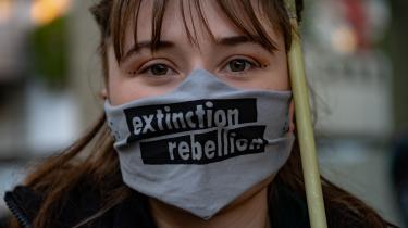 Extinction Rebellion-demonstrant i Berlin i oktober, hvor aktivister blokerede gaden foran Haus Der Wirtschaft (tysk pendant til Dansk Industri).