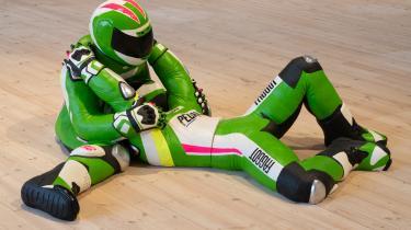 Værket Leatherboys består af tre store skulpturer af Formel 1-kørere, der omfavner hinanden på gulvet. Sponsorteksterne på deres kørerdragter er erstattet med nedsættende ord om homoseksuelle.