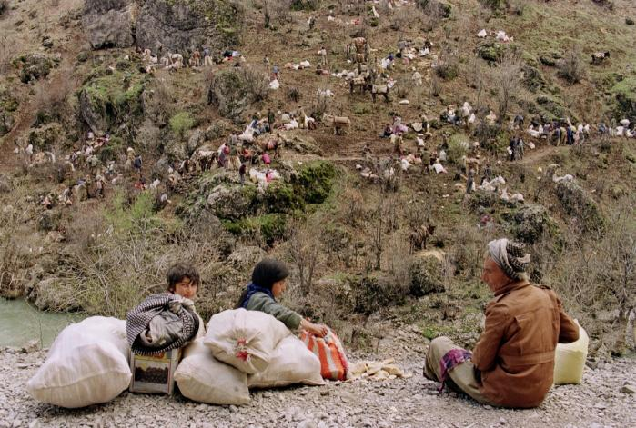 Irakiske kurdere på flugt fra kampene i det nordlige Irak i 1991. Da FN's sikkerhedszone blev oprettet senere samme år, vendte mange af flygtningene tilbage til den kurdiske del af Irak.