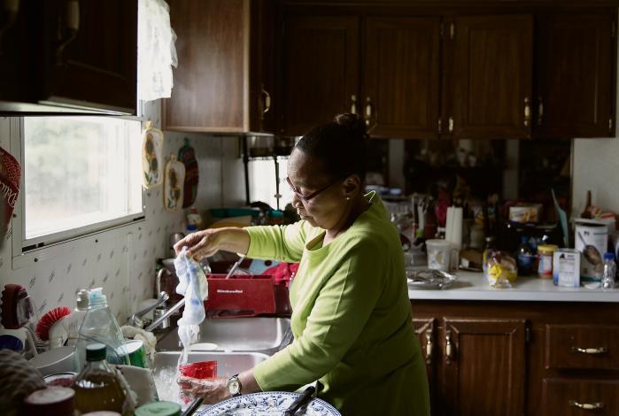 'Det var opfyldelsen af Martin Luther Kings drøm, at en sort mand en dag kunne blive valgt til præsident,' siger Sheila Blue, der anerkender, at Obama ikke har kunnet leve op til sine valgløfter. Men det er republikanernes skyld, mener hun.