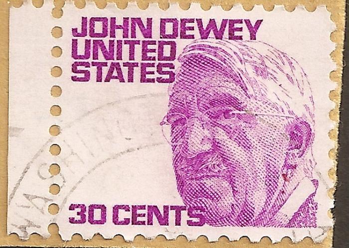 Den amerikanske filosof John Dewey definerer den ideelle lærer som lederen af en social gruppe: 'Han er leder, ikke i kraft af sin officielle position, men på grund af sin bredere og dybere viden og mere modne erfaring. Den antagelse, at princippet  om frihed skænker eleverne frihed, men at læreren er uden for dens rækkevidde og må frasige sig al lederskab, er slet og ret tåbelig.' Her ses han på et frimærke fra 1971.