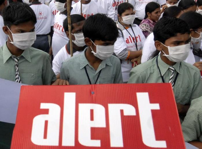 Skolebørn i den indiske by Hydarabad demonstrerer for at skabe opmærksomhed om svineinfluenzaen. Foto: Scanpix
