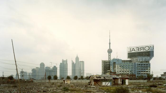 Område i udkanten af Shanghai, der skal ryddes for at gøre plads til nyt byggeri: Den kinesiske vækst fortsætter, men ofte med nyt byggeri, der ikke nødvendigvis er rentabelt, men alligevel figurerer i statistikkerne som økonomisk vækst. Foto: H. & D. Zielske/ Ritzau Foto