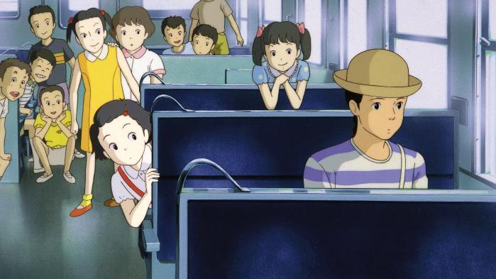 27-årige Taeko (til højre) tager på ferie på landet i selskab med – i tankerne – sit tiårige alter ego (på sædet lige bag voksne Taeko) og mange af sin barndoms oplevelser i Isao Takahatas charmerende 'Minder fra i går'. Foto: Camera Film