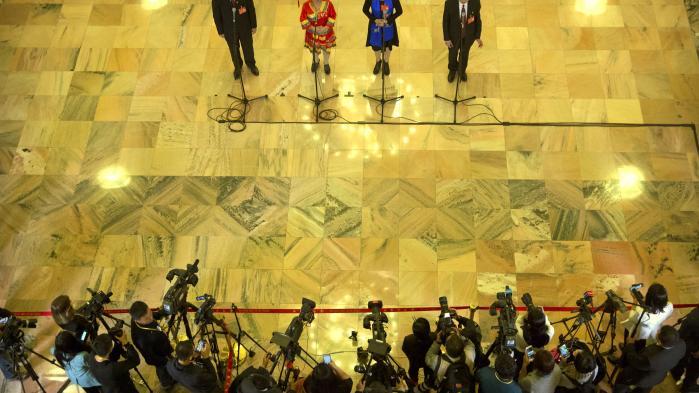 Partirepræsentanter taler med medierne under det kinesiske kommunistpartis 19. partikongres. Her holdt Xi Jinping lidt igen med at bruge ordet 'marked' i sin tale. Foto: Mark Schiefelbein/Ritzau Foto