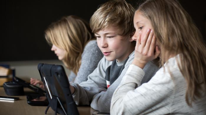 Folkeskoler forkorter lang skoledag med loven i hånden